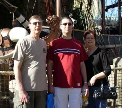 Dad, Travis, and Mom outside the Treasure Island