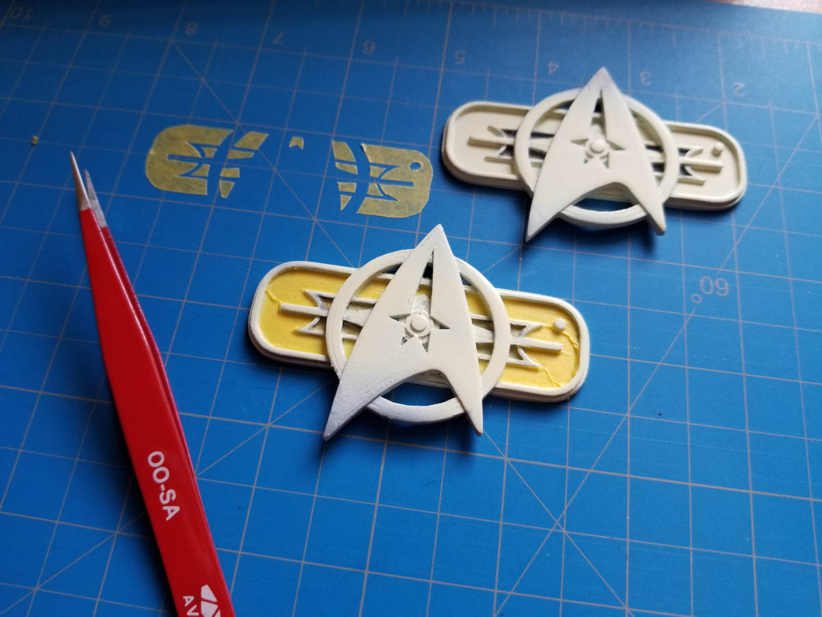 October 17, 2019: Masking the chest badges for painting